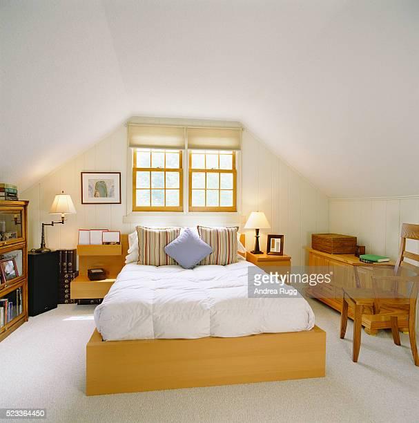 Wooden Furnishings on Attic Bedroom
