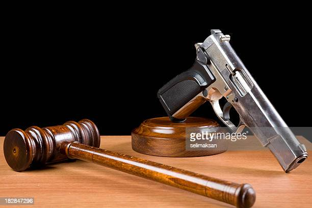 Wooden Gavel And Handgun On Table For Crime Punishment Concept