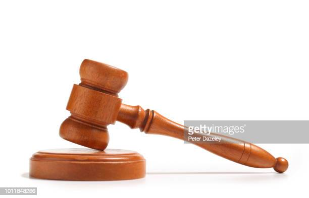 wooden gavel, side on, on white background - sentencing stock pictures, royalty-free photos & images