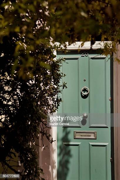 Wooden green door in Portobello Road, London (United Kingdom)