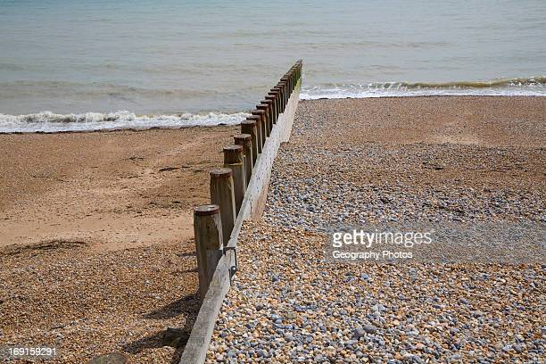 Wooden groyne showing different beach levels Eastbourne East Sussex England