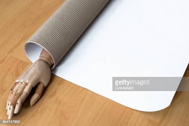 Wooden Hand With Copy Space On Cardboard.