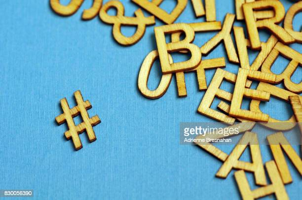 Wooden Hashtag Symbol And Jumbled Letters