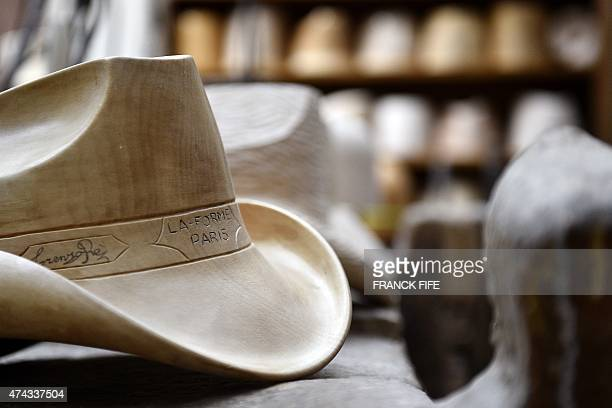 A wooden hat block is displayed at La Forme the workshop of block shaper Lorenzo Re in Paris on May 18 2015 Lorenzo Re is one of the last block...