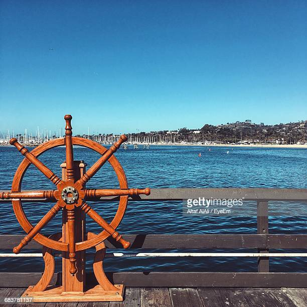 Wooden Helm On Pier Against Sea