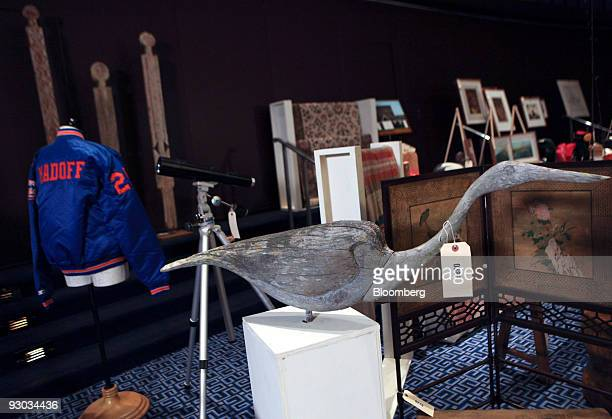 A wooden heron is displayed amoung other lotts during a media preview for an auction which includes jewelry and other personal items belonging to...