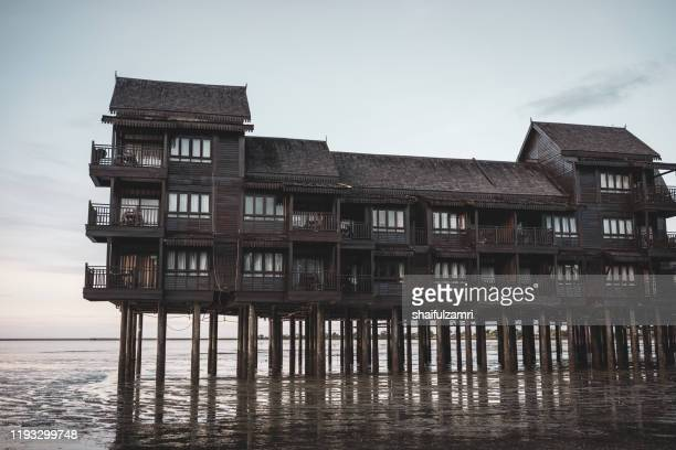 wooden hotel over majestic morning at langkawi island. - shaifulzamri - fotografias e filmes do acervo