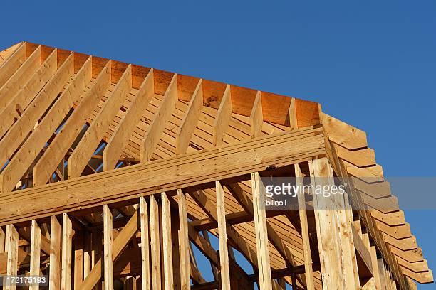 wooden house frame against blue sky
