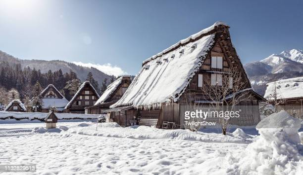 wooden house in village with white snow, the best for tourist travelling in japan at winter at shirakawa-go, traditional house gassho style - hokuriku region stock photos and pictures