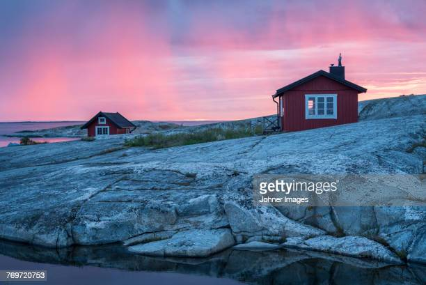wooden house on rocky coast - sweden stock pictures, royalty-free photos & images