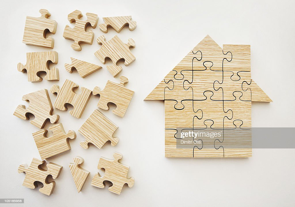 Wooden house shaped puzzle : Stock Photo