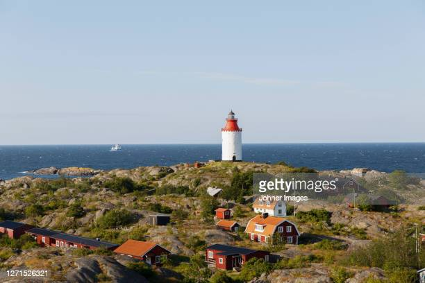 wooden houses and lighthouse at sea - sweden stock pictures, royalty-free photos & images