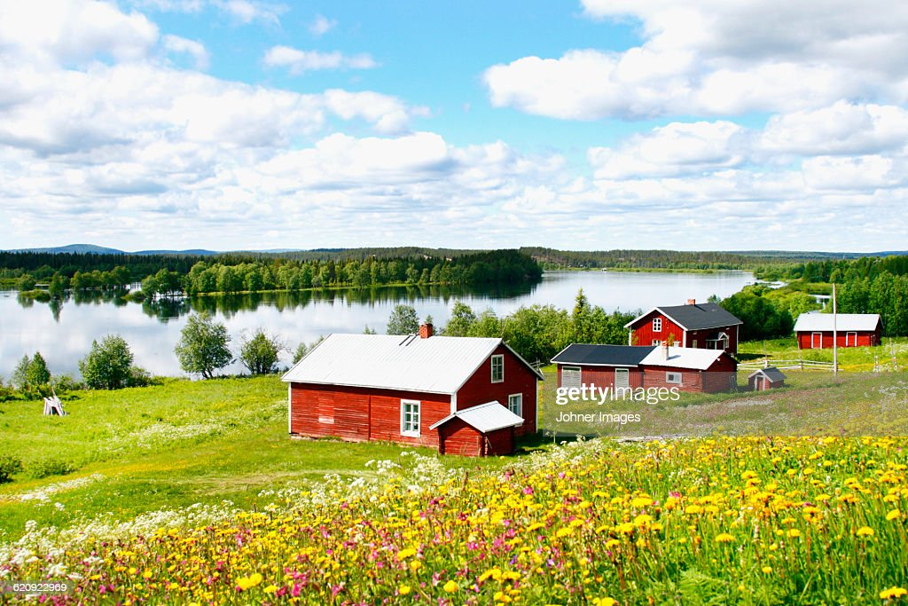 Wooden houses at lake : Stock Photo