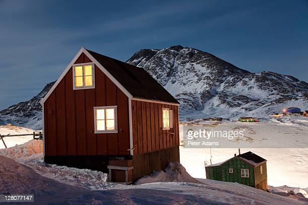 wooden houses at night, tasiilaq, e. greenland in winter - peter adams stock pictures, royalty-free photos & images