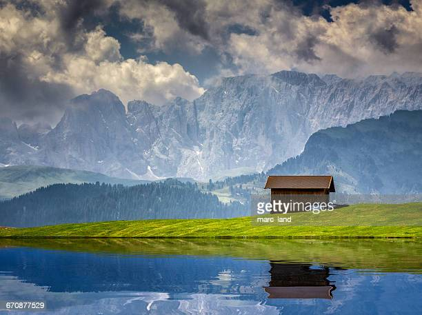 Wooden hut in Alpe di Siusi, Dolomites, Alto Adige, Italy