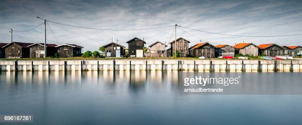 Wooden huts along seafront, Gujan-Mestras, Gironde, France