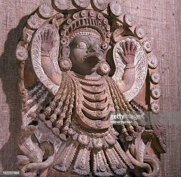 Wooden image of the winged Garuda sacred mount of Vishnu in Hindu religion The serpents represent the underworld Nagas India Hindu