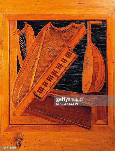 Wooden inlays depicting musical instruments. Isabella d'Este's music room, Ducal Palace, Mantua. Italy, 13th-16th century.