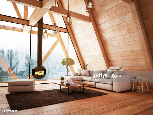 wooden interior with funiture and fireplace - camino foto e immagini stock