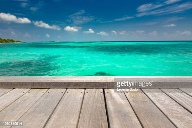 wooden jetty and sea view. horizontal tropical landscape for banner or website template. tropical island beach - website template stock photos and pictures