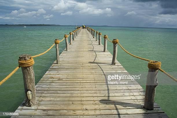 Wooden jetty at Fundu Lagoon, tropical luxury lodge on Pemba Island, Indian Ocean, near Zanzibar, Tanzania. .