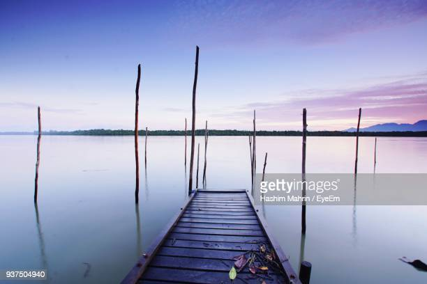 wooden jetty in lake against sky - sarawak state stock pictures, royalty-free photos & images
