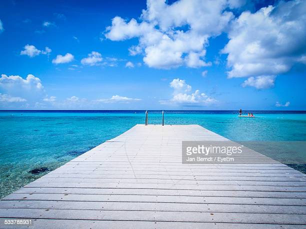 wooden jetty in sea - jetty stock pictures, royalty-free photos & images