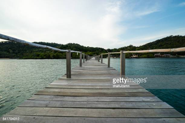 wooden jetty in sibu island of johor, malaysia - shaifulzamri stock pictures, royalty-free photos & images