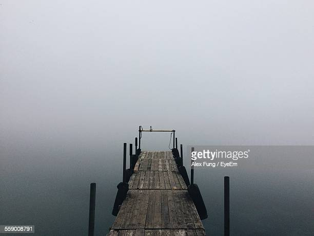 Wooden Jetty On Calm Lake