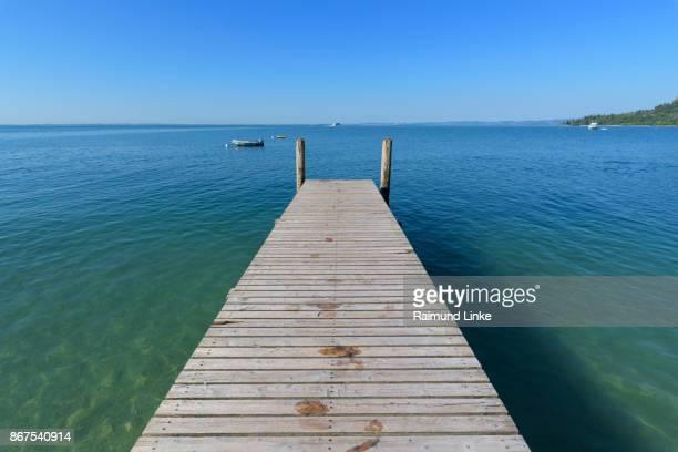 Wooden jetty on the lake, Garda, Lake garda, Lago di Garda, Veneto, Italy