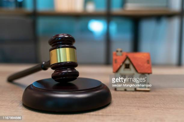 wooden judge gavel with house isolated - auction stock pictures, royalty-free photos & images