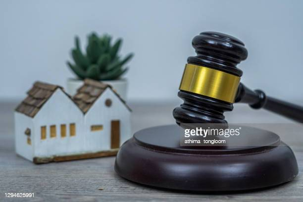 wooden judge hammer and house model. - gavel stock pictures, royalty-free photos & images