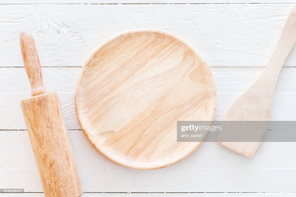Wooden kitchen utensils on white  kitchen table : Stock-Foto