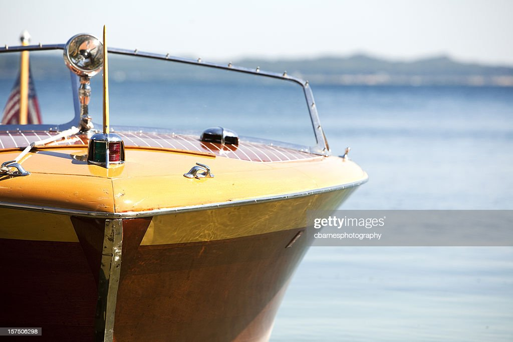 wooden lake michigan antique vintage power boat in blue daylight : Stock Photo