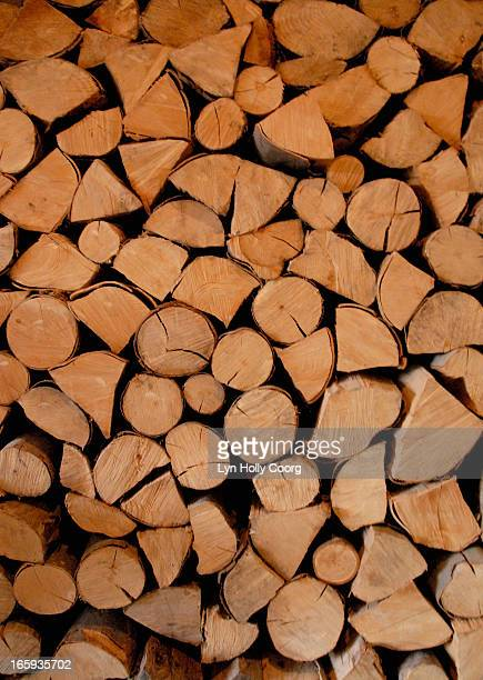 wooden logs piled in a stack - lyn holly coorg photos et images de collection