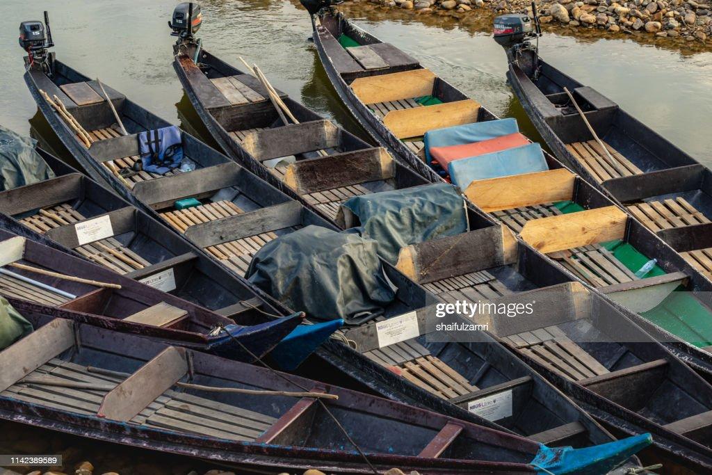 Wooden long boats parked at Kuala Tembeling jetty. : Stock Photo