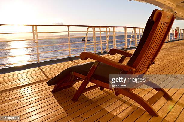 Wooden lounge chair on the deck of a cruise ship