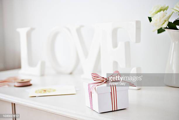 Wooden 'love' letters decoration and gift box with ribbon on desk