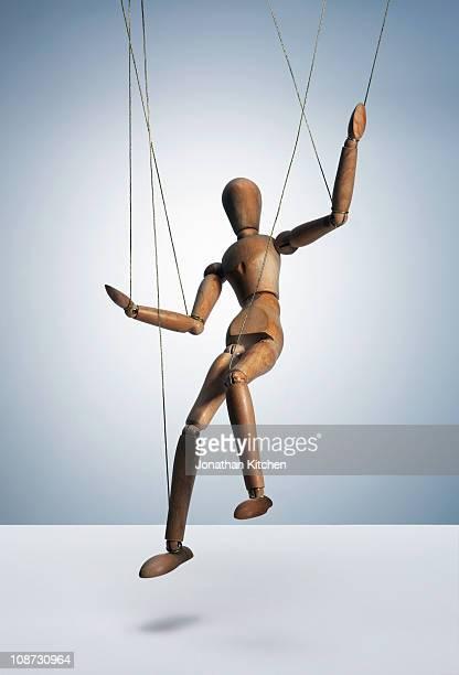 Wooden man on strings