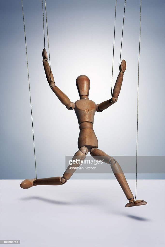 Wooden man with strings : Stock Photo