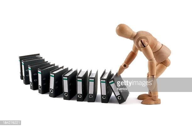 wooden mannequin and domino with folders
