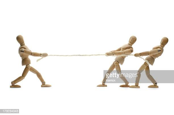 wooden mannequin and tug of war