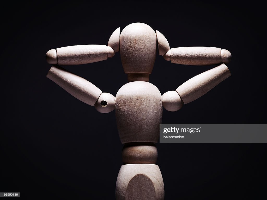 Wooden Mannequin Covering Ears. : Stock Photo