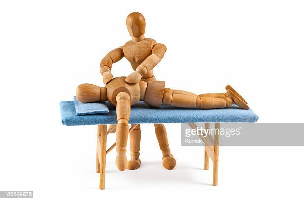 wooden mannequin gives a massage - relaxing time