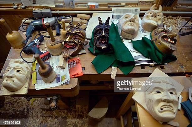 A wooden mask that Wood sculptor Adrian Burger is preparing for a client for Carnival locally called Fastnacht or Fasnet pictured at his workshop on...