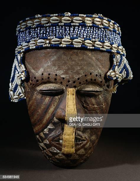 Wooden mask with headdress of pearls and shells Kuba people Democratic Republic of the Congo Leida Rijksmuseum Voor Volkenkunde
