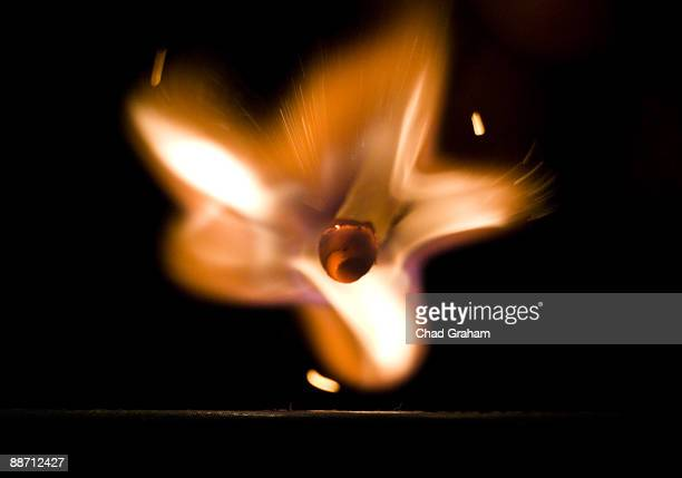 wooden match being lighted - match lighting equipment stock photos and pictures