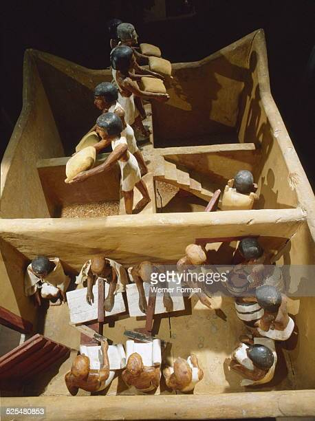 Wooden model depicting a granary The scribes record the produce while workers empty the sacks of grain Egypt Ancient Egyptian 11th dynasty c21341991...