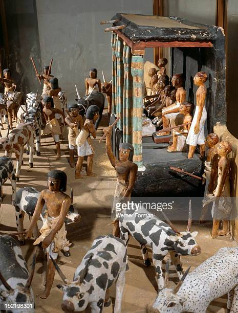 Wooden model depicting the tomb owner Meketre and his son assisted by scribes and herdsmen inspecting and counting his livestock Egypt Pharaonic...