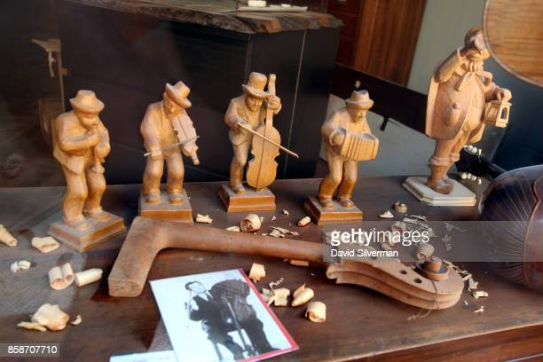 Wooden musician are displayed in the window of a violinmaker's studio on March 25 2017 in Cremona Italy The city is noted for its musical history and...